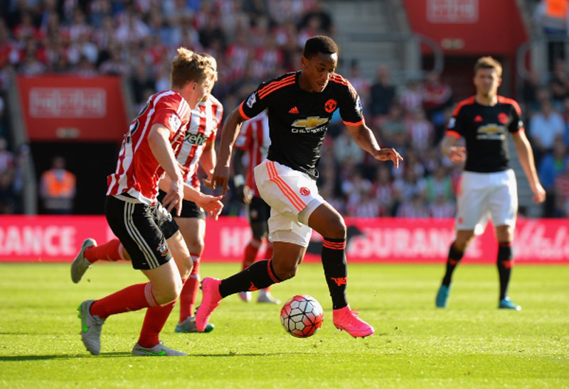 XXXX of Southampton is tackled by XXXX of Manchester United during the Barclays Premier League match between Southampton and Manchester United at St Mary's Stadium on September 20, 2015 in Southampton, United Kingdom.